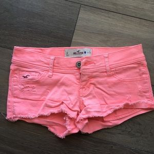 Neon pink ripped shorts